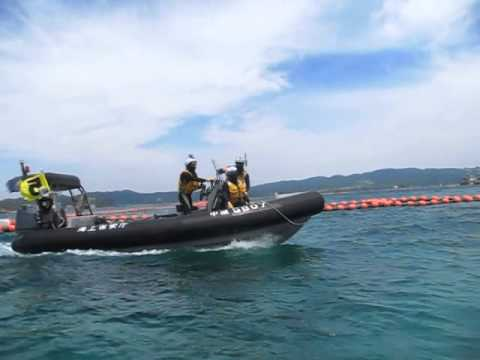 Coastguard following boat with media in Oura Bay, Henoko. Okinawa US military base protest