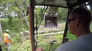 hand-cutting-trees-over-a-fiber-optic-line