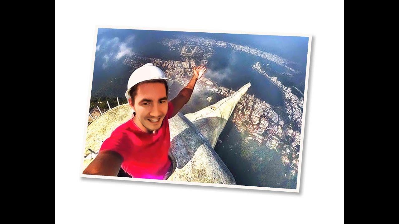 Extreme Selfie On The Jesus Statue In Rio De Janeiro Brazil - Guy takes epic selfie top christ redeemer statue brazil
