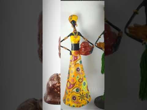 Handmade paper dolls - news paper dolls - african women dolls made by news paper