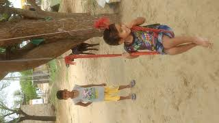 Little girl swinging in Village