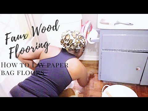 PAPER BAG FLOORING// HOW TO LAY FAUX WOOD PLANK FLOORS- DIY