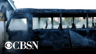 Military bus bombing in Syria's capital kills at least 14 people