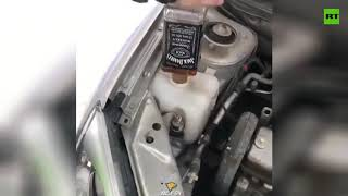 Russian traffic cops pour whiskey in patrol car instead of wiper fluid