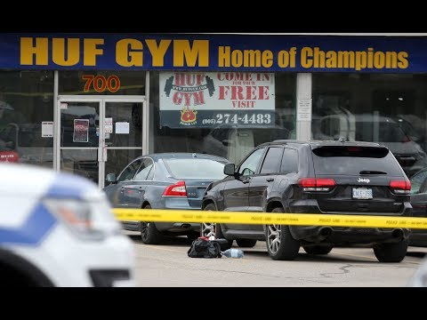 Two arrested, one sought in slaying of Hells Angel in