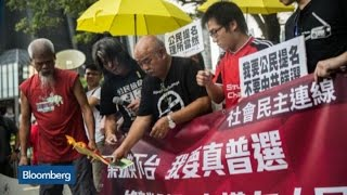 Top Photos: Activists Burn Photos of Hong Kong Chief Executive