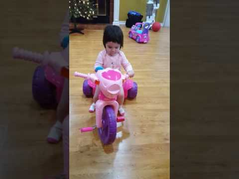 Olivia Rides Barbie Tricycle