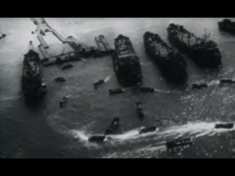 Okinawa US Navy Ships Pound Beach 10th Army Goes Ashore Aerial Beachhead Footage