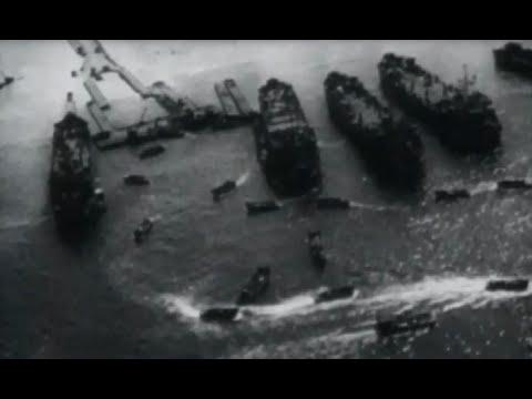 Okinawa US Navy Ships Pound Beach 10th Army Goes Ashore Aerial Beachhead Footage