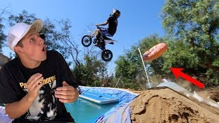 Ramping DIRT BIKE over BACKYARD pond(ft. Funk Bros)