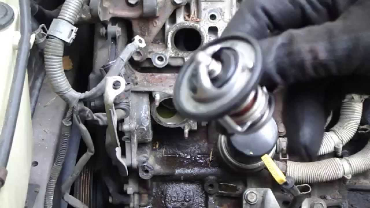 How to replace thermostat Toyota Camry 22 liter engine Years 1991 to 2002  YouTube