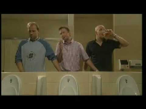 Men peeing together