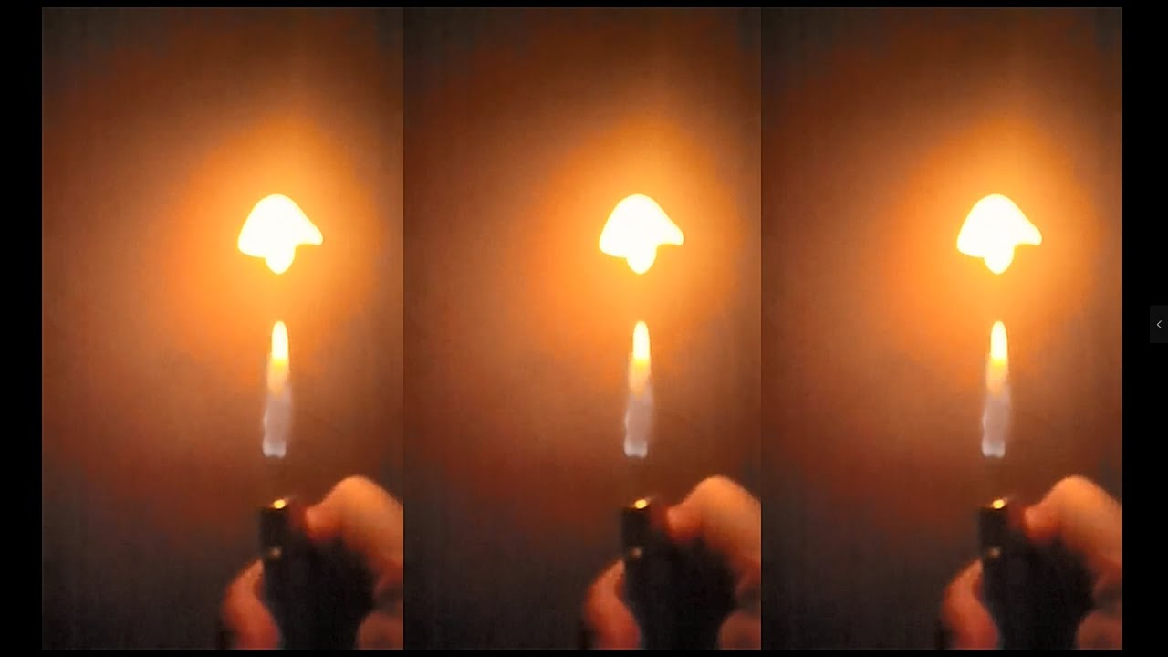 The magical moment of lighter ignition and alcohol spraying on the candle-Daily Slow motion
