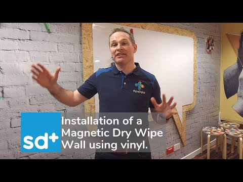 Installation of a Magnetic Dry Wipe Wall using vinyl.