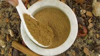 A blend of mix spices - Indian garam masala powder in a spacious stone bowl