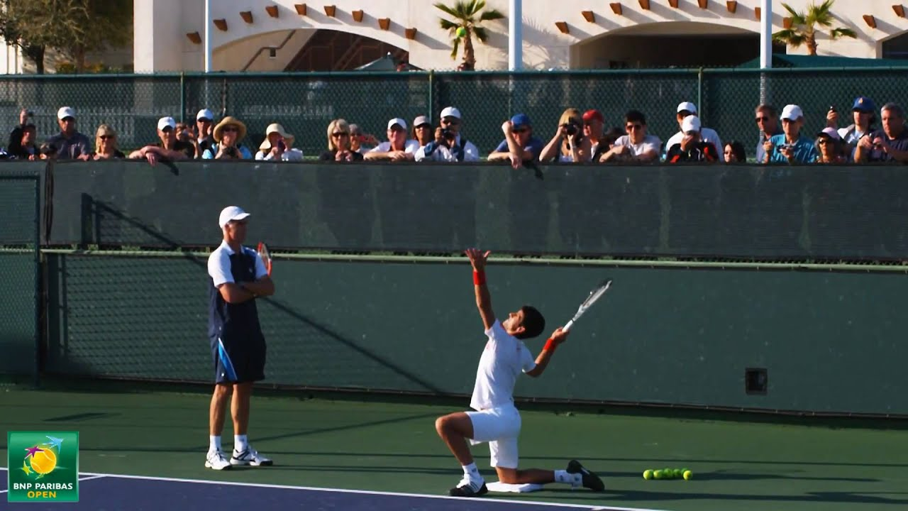 novak djokovic and todd martin practice serving drills