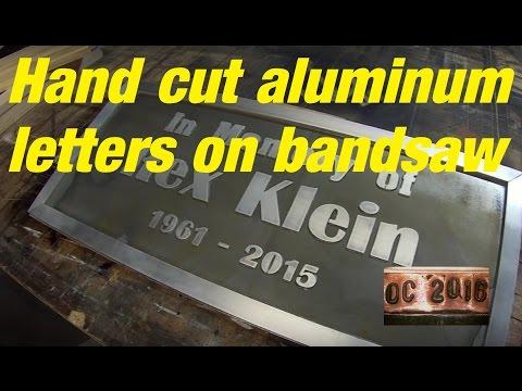 DC. Hand cut aluminum letters name plaque