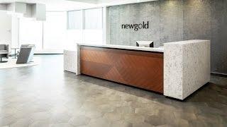 Custom White Quartz Corporate Office Reception Desk | New Gold Inc. | ASTOUND Group<
