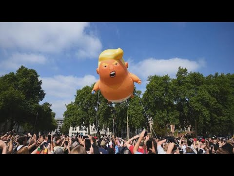 """""""Trump baby"""" balloon takes flight as protesters converge in London"""
