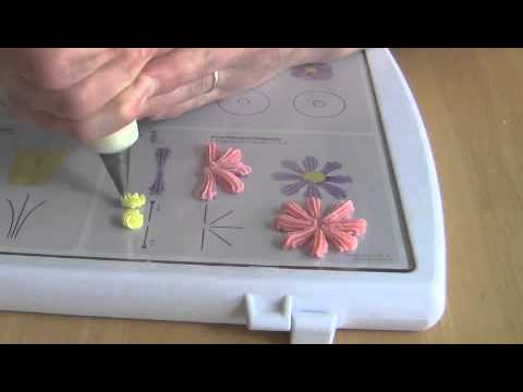 Cake Decorating How To Make Daisies : Cake Decorating Piping Techiniques: How to Make a Daisy ...