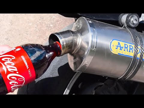 pouring-coca-cola-in-a-motorcycle-exhaust