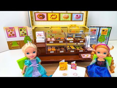 Elsa and Anna toddlers at Mister Donut and bakery