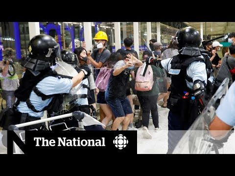 Hong Kong airport in chaos as protesters, police clash