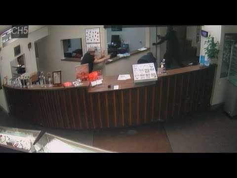 Tense moment hero jeweler gets in shootout with armed robbers who took his coworkers hostage