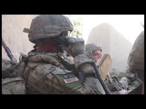 War in Afghanistan - Radio operator calling in air strike archival stock footage