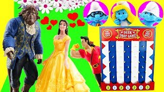 Smurfs & Beauty and The Beast Movie Disk Drop Game! Belle, Smurfette & Gaston open Toy Surprises! thumbnail