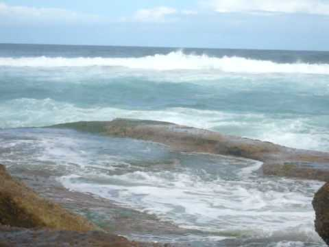 beautiful waves crashing on the rocks at bronte beach