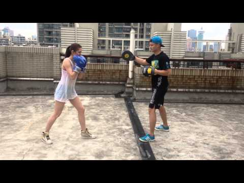 Girl boxing on the rooftop Shanghai Pudong
