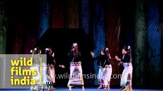 Young tribal girls in wrap-around skirts dance to modern Nyishi song in India