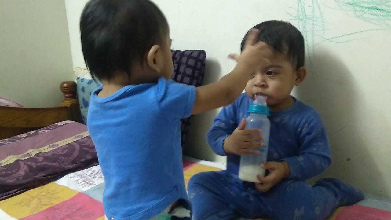 Twin baby boys fighting for milk bottle - YouTube