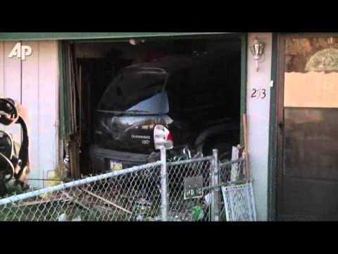 Raw Video: SUV Crashes Into Alaska Living Room