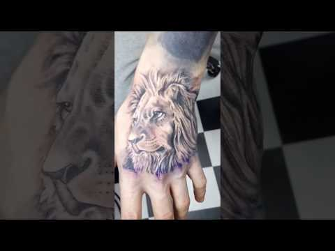 Sick Lion Tattoo in Hand