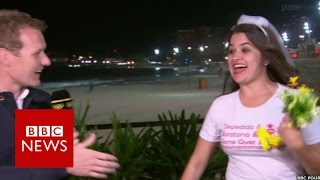 Moment bride-to-be crashes Olympic coverage - BBC News