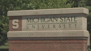Michigan State University president urged to resign over controversial emails