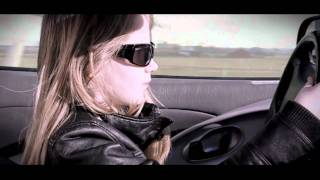 10 year old girl driving a sports car