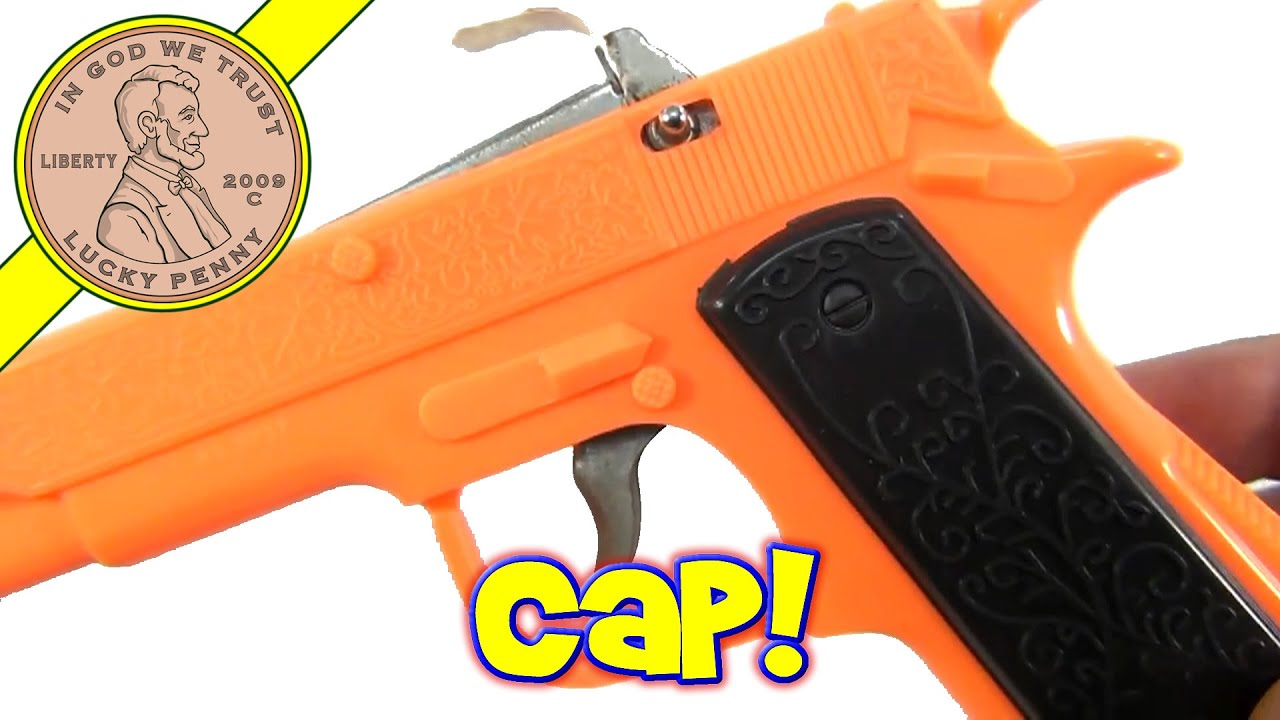 Toys For Caps : Neon orange imperial plastic toy cap gun with paper roll