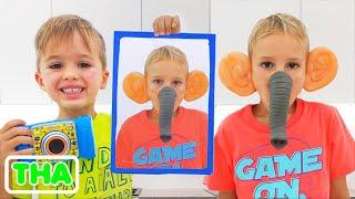 วลาดและนิกิเล่นกับรูปถ่าย   วิดีโอตลกสำหรับเด็ก