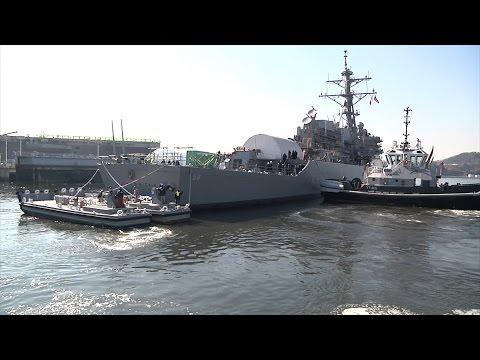 USS John S. McCain leaves drydock