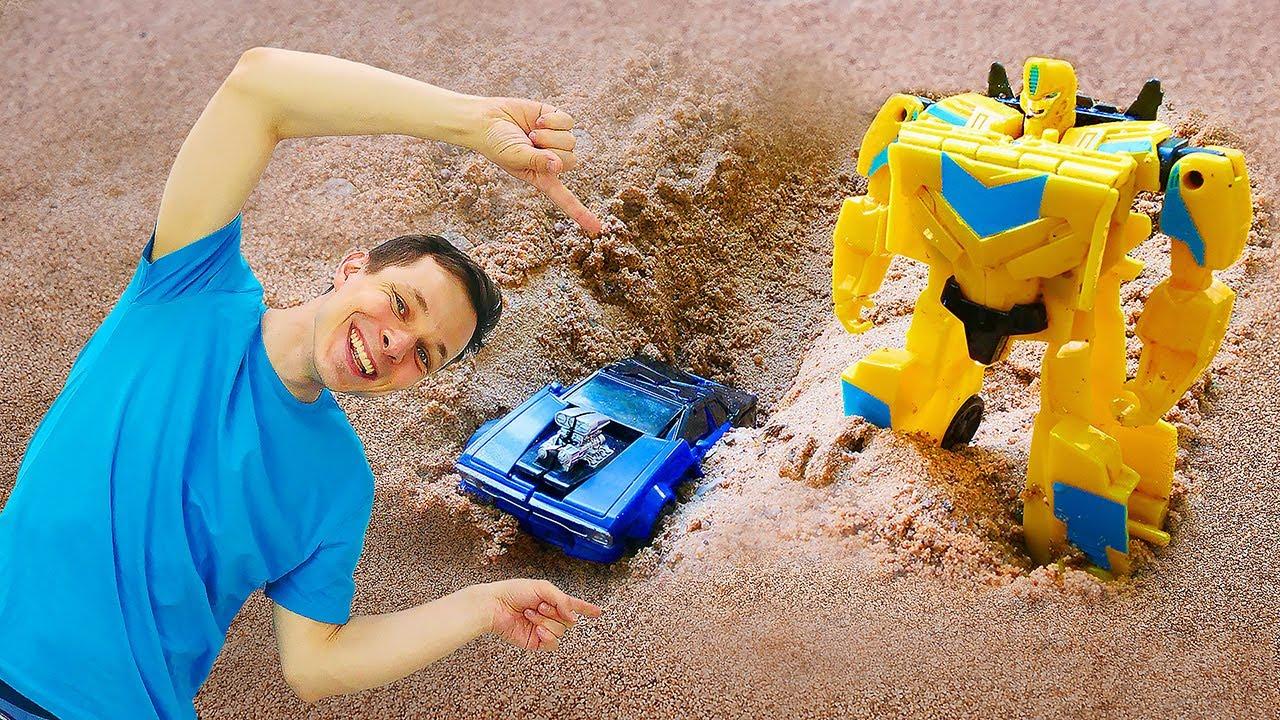 Трансформеры - Бамбли и Оптимус строят новую базу из песка.