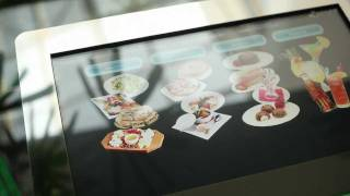 видео eMenuTable - стол со встроенным сенсорным дисплеем