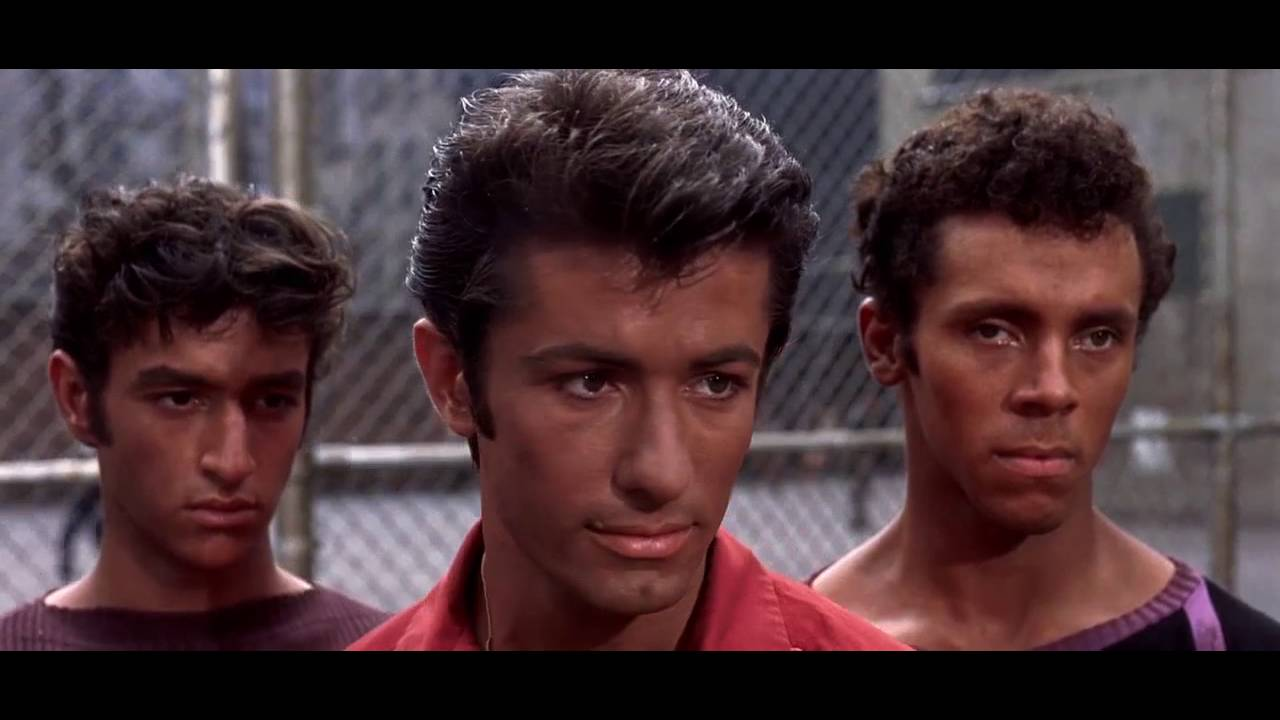 The Gangs fight in the street (West Side Story)