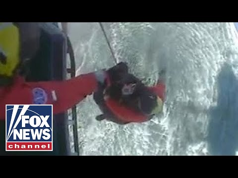 Watch: British coast guard rescue shark bite victim