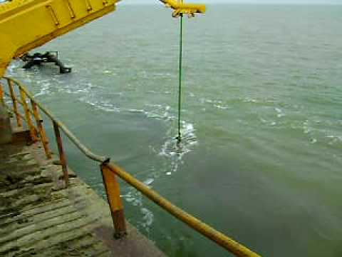 Dredge pipe comes above the surface