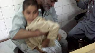 scared child from injection in DR FAISAL KHANs clinic