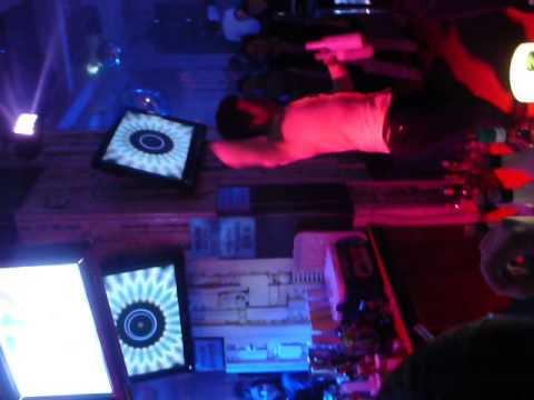 A bartender juggling at a club in Qingdao