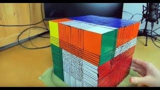 2 year old solves giant rubix cube...
